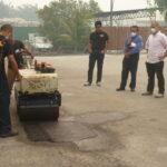 Malaysia - JKR Plant Visit 2013 (Pothole repair)